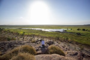 Kakadu - lady watching the sunset over Ubirr - Luxury Private Air Tour