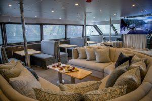 Stewart Island - Fiordland Jewel, lounge area enjoying a wine - Luxury short breaks New Zealand