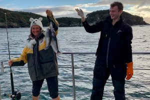 Stewart Island - catching fish onboard the cruise - Luxury solo tours