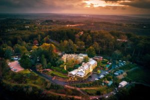 Adelaide - aerial view of Mount Lofty House glowing on the mountain - luxury short breaks South Australia