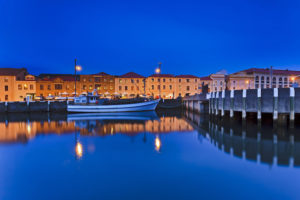 Hobart - the harbour lit up at night with a lone boat - Luxury short breaks Tasmania