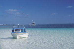 Eyre Peninsula - boats moored in crystal clear waters - luxury short breaks South Australia