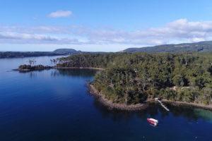 Port Arthur - boat pulling into Stewart Bay - Luxury Short Break Australia