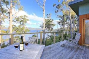 Port Arthur - wine on the balcony at Stewart Bay lodge - Luxury Short Breaks Australia