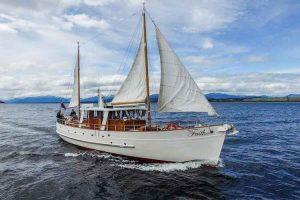 Lake Te Anau - historic motor yacht cruise aboard Faith - Luxury solo tours