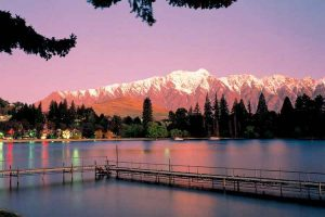 Queenstown - pink and purple sunset over the ski fields - Luxury solo tours