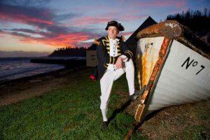 Norfolk Island - captain standing beside shipwreck - luxury short breaks