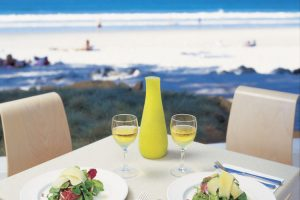 Noosa - enjoying a wine and lunch overlooking the beach - Luxury short breaks Australia