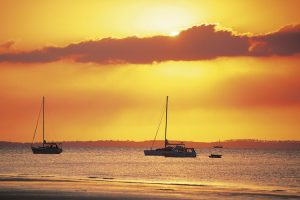 Fraser Island - boats moored at sunset on Seventy Five Mile Beach - Luxury solo tours