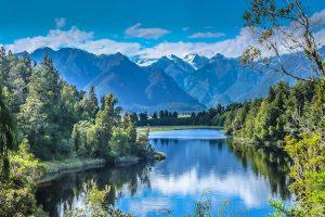 Lake Matheson - lake surrounded by native trees - Luxury short breaks New Zealand