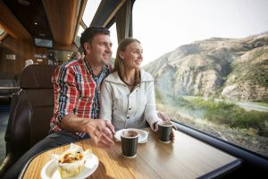 South Island - couple enjoying the view from the TranzAlpine traing - Luxury short breaks New Zealand
