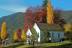 Harrietville - quaint Church surrounded by autumn trees - Luxury short breaks Australia