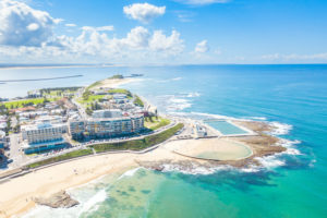 Newcastle - aerial view of beaches and ocean baths - luxury short breaks New South Wales