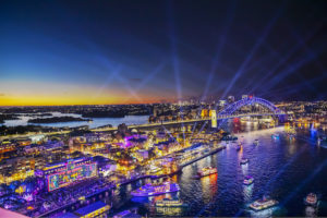 Sydney - Harbour bridge and boats illuminated for Vivid festival - luxury short breaks New South Wales